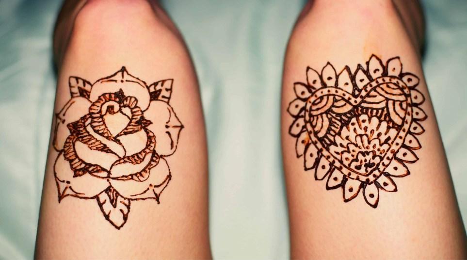 henna temporary tattoo art of roses on leg