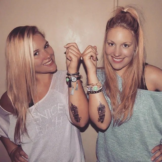 Feather tattoos for sisters