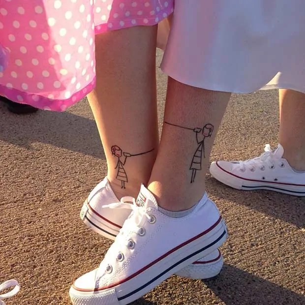 sisters matching foot tattoos