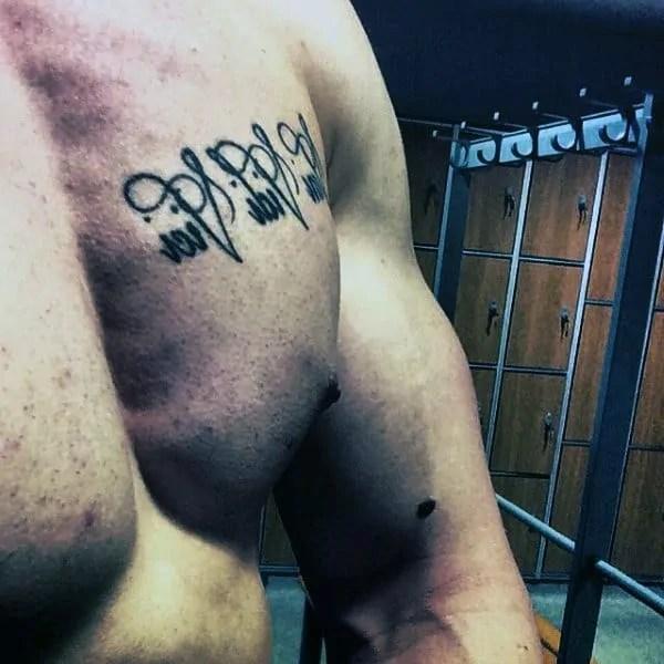 men veni vidi vici tattoo on upper chest