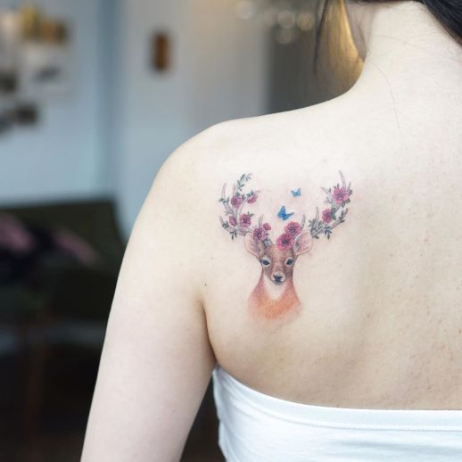 Ciervo con flores por Tattooist Silo