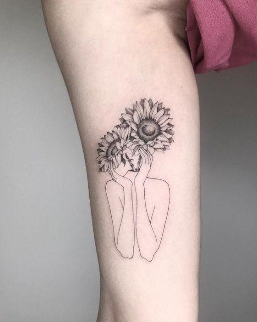 Silueta mujer con flores girasoles