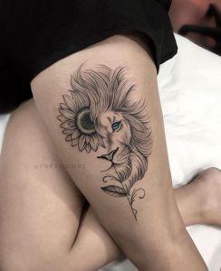 León y flor de girasol