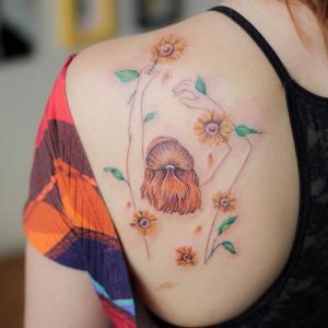 Silueta de mujer en un campo de girasoles por Luciana Periard, Art Efeito