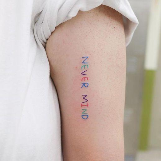 Frase: Never mind por U. Tattoo