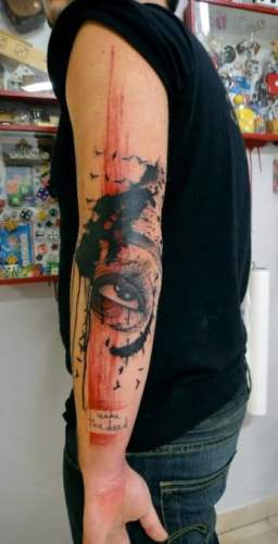 Tatuaje Xoil en el brazo
