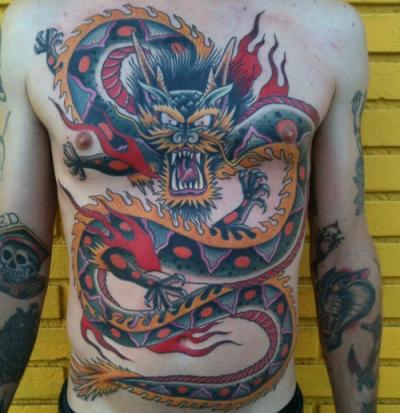 Dragon tattoo at chest