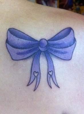 Purple bow tattoo