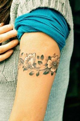 flowerr tattoos on the arm