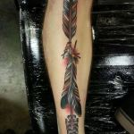 Arrow and feather tattoo
