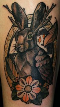 surrealist bunny tattoo