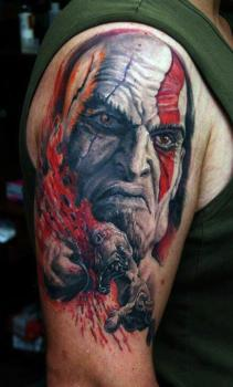 Kratos tattoo on shoulder