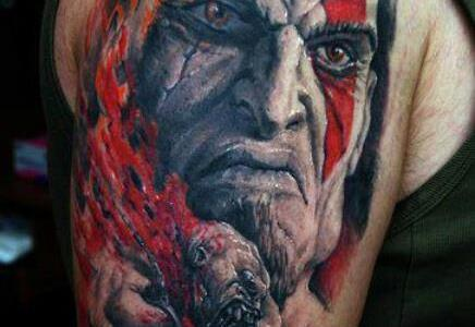 Kratos tattoo on shoulder