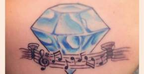 Diamond and music tattoo