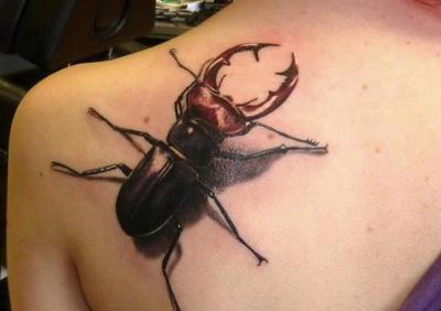beetle tattoo on the back