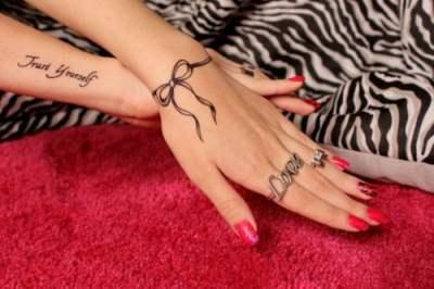 Ribbon tattoo on wrist