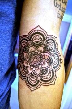 Forearm mandala tattoo