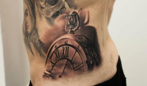Pocket watch tattoo on the hip
