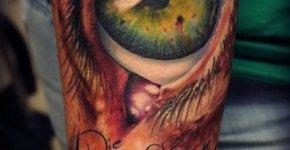 Green realistic eye tattoo