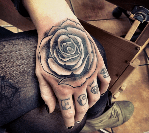 08ace039d A black rose tattooed on the back of the hand of a woman. Usually the  flower tattoos are done with colored inks, but there are interesting  exceptions like ...
