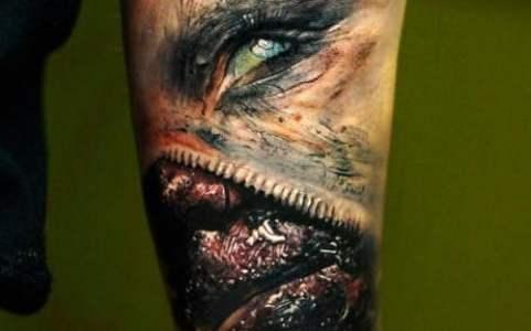 Tatuaje zombi en el brazo