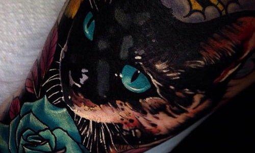 Tatuaje gato ojos azules