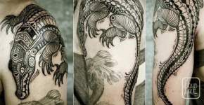 Tatuaje cocodrilo en el brazo