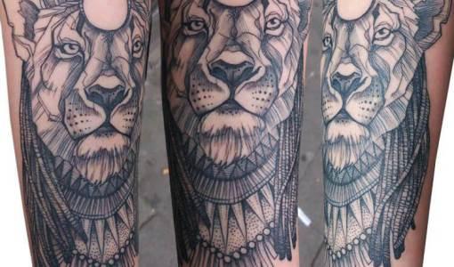Tatuaje leona en el brazo