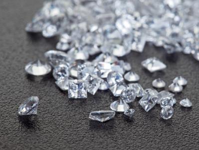 Loose diamonds on black surface