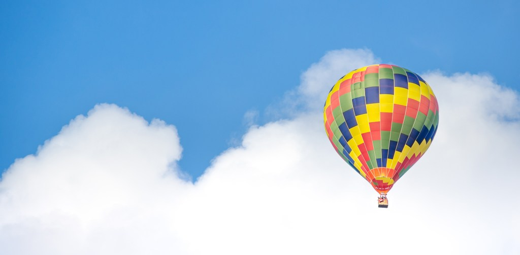 A hot air balloon in front of a blue sky