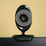 An oval shaped black web camera