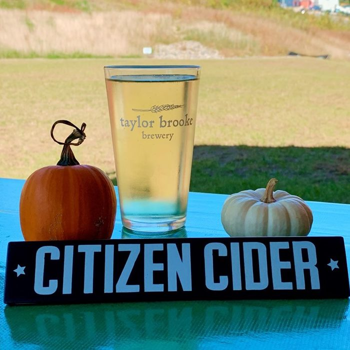 "A logo glass from Taylor Brooke Brewery filled with Citizen Cider ""Lake Hopper""."