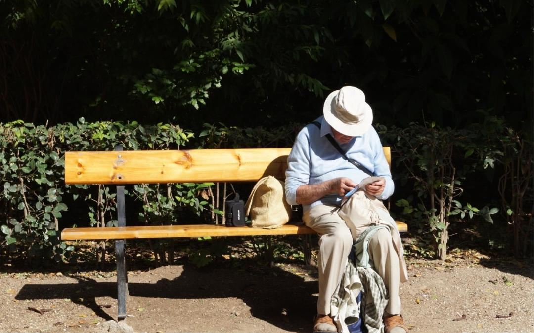 elderly man looking at papers