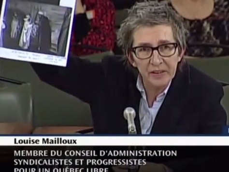 Louise Mailloux holding up a photocopied image of sheiks to prove a point about something...