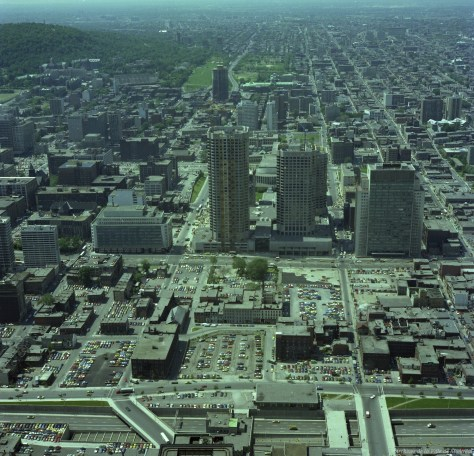 Complexe Desjardins, August 1976 - Archives de Montréal. In the foreground, the Ville Marie Expressway and what remained of Chinatown. In the background, the controversial La Cité complex is under construction.