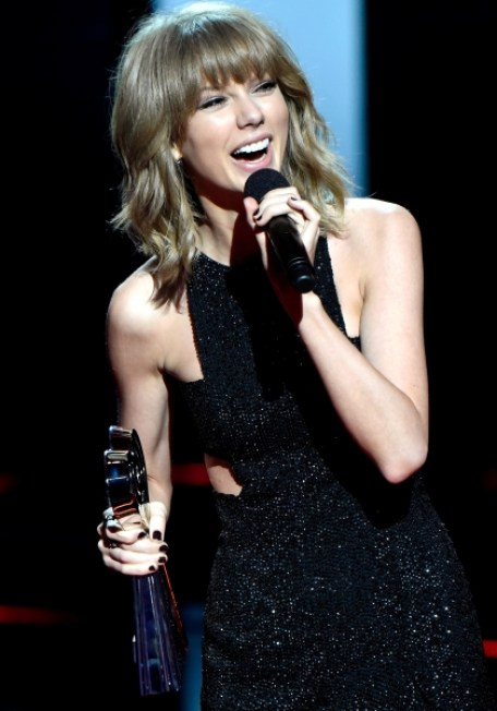 Taylor Swift accepts three awards at iHeartRadio Music Awards 2015 including Artist of the Year.