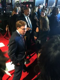 Bob Costas, sports broadcaster doyen, breezes past the red carpet to watch one of the biggest controversies in sports unfold on the big screen.