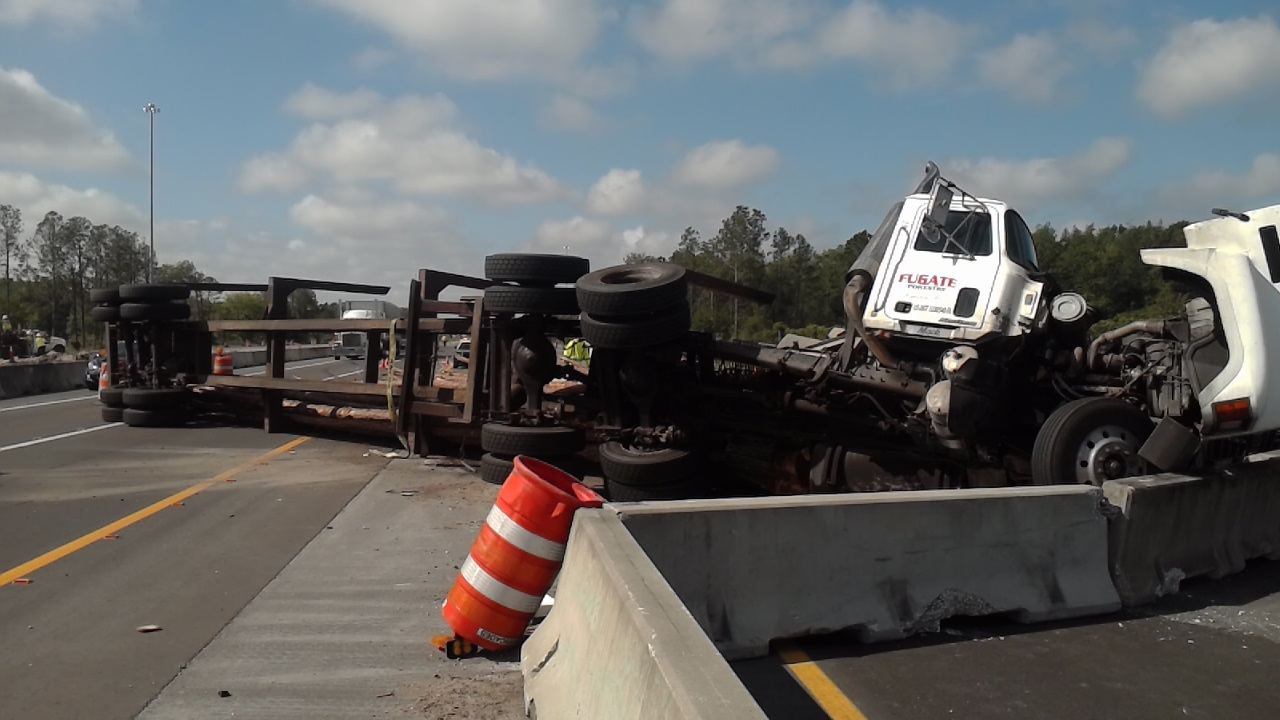 log truck overturns  closing section of northbound i