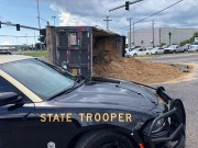 Driver Seriously Injured When Dump Truck Overturns