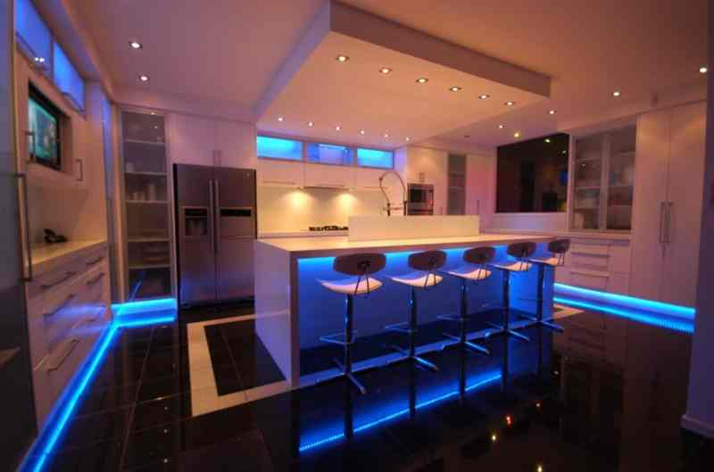 A modern kitchen with decorative LED lighting