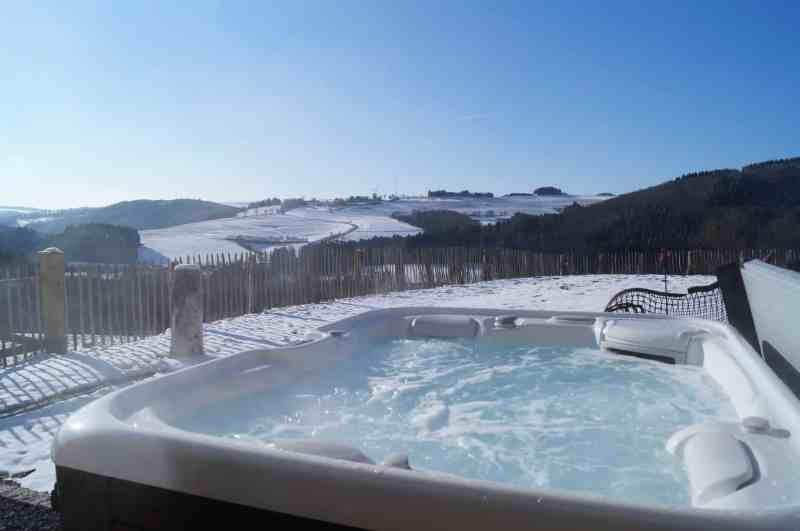 A hot tub with safe outdoor wiring on a snowy day