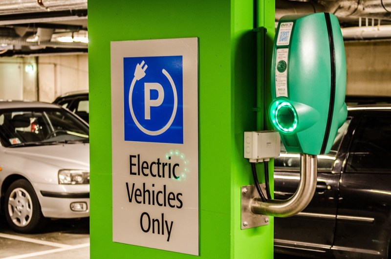 a multifamily ev charger in a parking garage