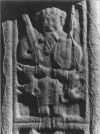 Figure 2 Image of a secular potentate on the high cross at Durrow. Photo. R. Moss.