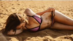sexy lady resting on sand