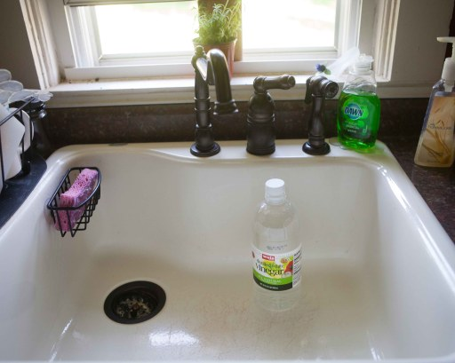 Step 2: Have a Clean sink and fill with 1 part White Vinegar and 10 parts Water