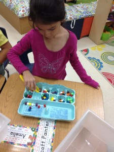 Using tweezers took this sorting center into fine motor practice too!