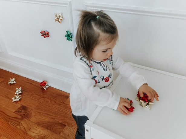 A simple and cheap Christmas or holiday activity to do with your babies and toddlers to teach them colors, actions words, and just have fun
