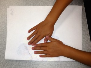"""Pressing folded paper to """"smoosh"""" paint"""