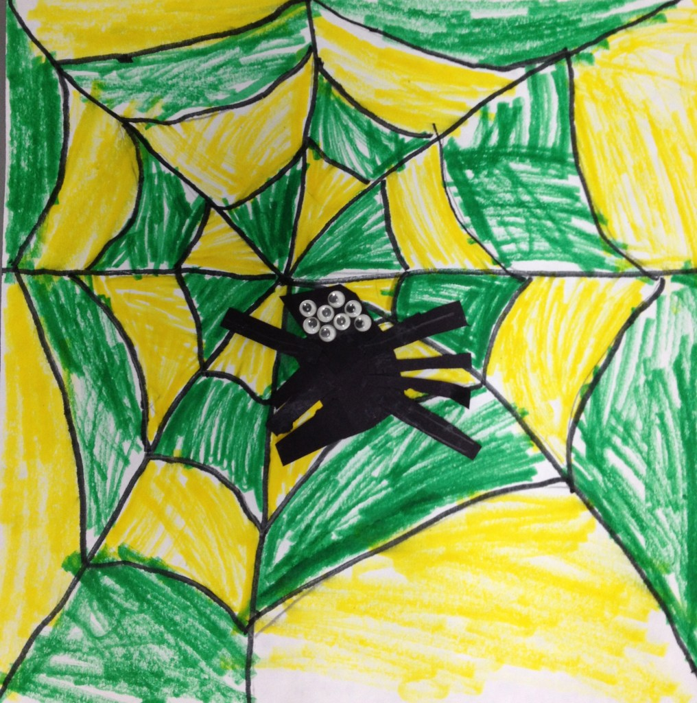 Green and yellow spiderweb with spider