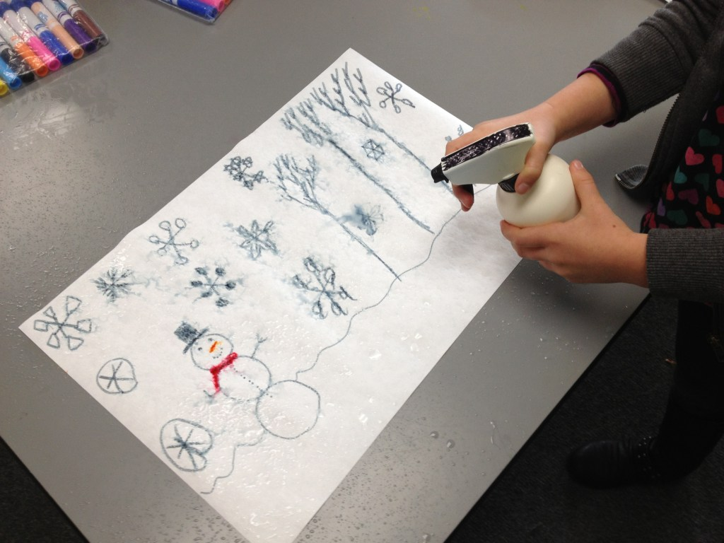 Student spraying water on her monochromatic snow scene